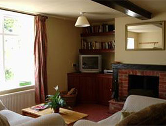Rose Cottage cosy living room with wood burner stove